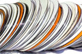 Stack of orange and white compact discs extreme close up Royalty Free Stock Images