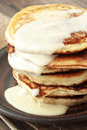 Stack of pancakes with condensed milk on wooden background Stock Photos