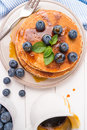 Stack of pancakes with fresh blueberry and caramel syrup Royalty Free Stock Photo