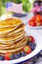 Stack of pancakes with fresh fruit, syrup and butter Royalty Free Stock Photo