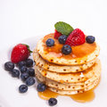 Stack of pancakes with fruits Royalty Free Stock Photo