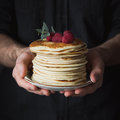 Stack of pancakes in man hands Royalty Free Stock Photo