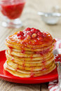 Stack of pancakes with strawberry jam in a plate on a wooden rustic table Stock Photography