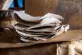 Stack of paper sheets in an ancient paper mill. Old traditional Royalty Free Stock Photo