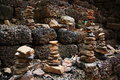 Stack of pebble towers on laterite stone wall Royalty Free Stock Image
