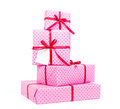 Stack of pink presents on white background Royalty Free Stock Photography