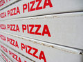 Stack of pizza boxes Stock Photo