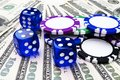 Stack of Poker chips with blue dice rolls on a dollar bills, Money. Poker table at the casino. Poker game concept. Playing a game Royalty Free Stock Photo