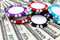 Stack of Poker chips on a dollar bills, Money. Poker table at the casino. Poker game concept. Playing a game with dice. Casino Royalty Free Stock Photo