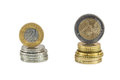 Stack of polish zloty and euro coins isolated on white background with clipping path Stock Photos