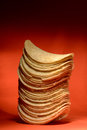 Stack of potato chips tall on an orange background Royalty Free Stock Photography