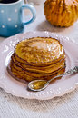 Stack of pumpkin pancake pancakes on vintage plate decorated an entire Royalty Free Stock Photos