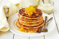 A stack of pumpkin pancakes topped with pumpkin in syrup preserves Royalty Free Stock Photo