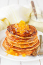A stack of pumpkin pancakes topped with pumpkin in syrup preserves copy space for your text Stock Image