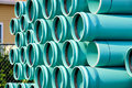 Stack of PVC water pipes Royalty Free Stock Image