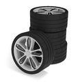 Stack of racing car wheels on white background Stock Photography