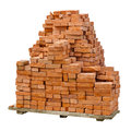 Stack of red clay bricks on white background Stock Photos