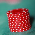 Stack of red gambling chips Royalty Free Stock Photo