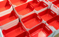 Stack of red plastic trays arrangement for background