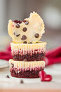 Stack of red velvet mini cheesecakes vertical composition Stock Photo