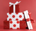 Stack of red and white polka dot theme festive gift box presents Royalty Free Stock Photo