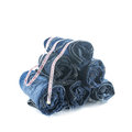 Stack of rolled jeans with tape measure isolated on white Royalty Free Stock Image