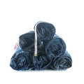 Stack of rolled jeans with tape measure isolated on white Stock Photos