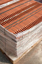 Stack of roofing tiles packaged on a wooden pallet on a construction site Royalty Free Stock Photo