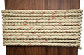 Stack of rope on brown wood with white background for design Royalty Free Stock Photo