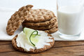 Stack of round rye crispbreads on wood with white napkin. One sp Royalty Free Stock Photo