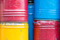 Stack of rusty chemical barrels colorful Stock Photos