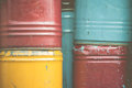 Stack of rusty chemical barrels colorful in vintage tone Stock Images