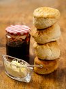 Stack of scones photo delicious stacked on a table with clotted cream and jam Stock Photography