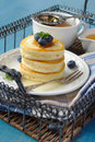 A stack of scotch pancakes with with honey and blueberries on tray Stock Photography