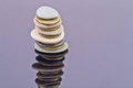 A stack of sea stones and gold coins Royalty Free Stock Photo