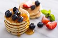 Stack of small pancakes with berries Royalty Free Stock Photo