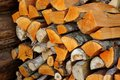 Stack of split firewood a by a wooden wall Stock Images
