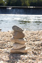 A stack of stones near the water Stock Photography
