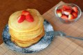 Stack of sweet pancakes with fresh strawberries and icing sugar Royalty Free Stock Photo