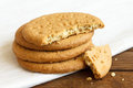 Stack of sweetmeal digestive biscuits on dark wood and napkin Stock Photos
