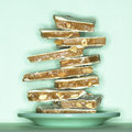 Stack ten peanut butter brittle candy teal green plate background Stock Photography