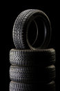 Stack of tires in dark ambient on black background vertical shot a a Royalty Free Stock Image