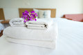 Stack of towels in the bed Royalty Free Stock Photo