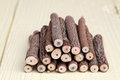 Stack of tree trunk pencils on wooden table Royalty Free Stock Image