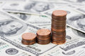 Stack US pennies in an ascending bar graph on background with money american hundred dollar bills Royalty Free Stock Photo