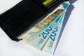 Stack of various of israeli shekel money bills in open black lea Royalty Free Stock Photo
