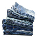 Stack various pairs jeans pants isolated white background Stock Images