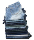 Stack various pairs jeans pants isolated white background Stock Photography