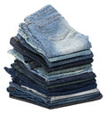 Stack various pairs jeans pants isolated white background Royalty Free Stock Photo