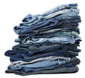 Stack various pairs jeans pants isolated white background Stock Photo